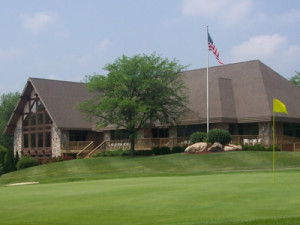 A nice view of the LCC's exquisite club house overlooking the 8th green.